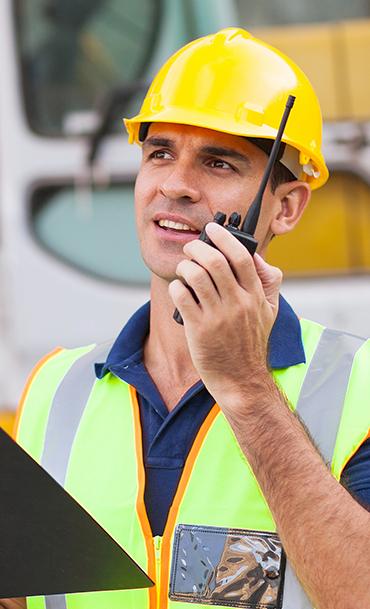 Road builder on walkie-talkie